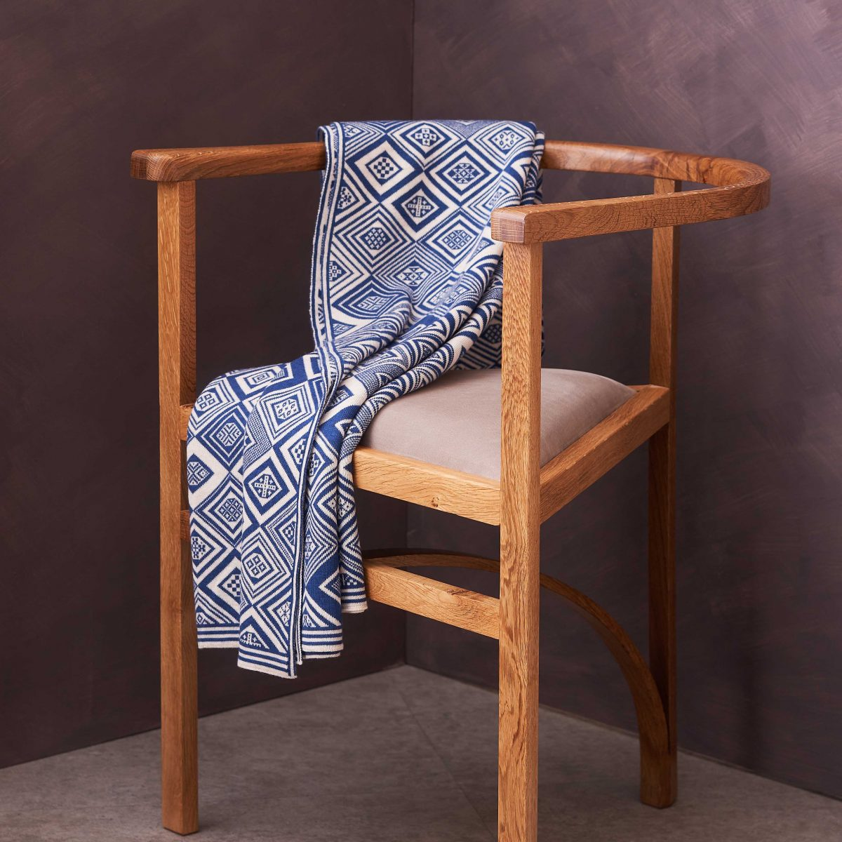 Blue and White throw by BAKKA drapped over prism chair by Angus Ross.